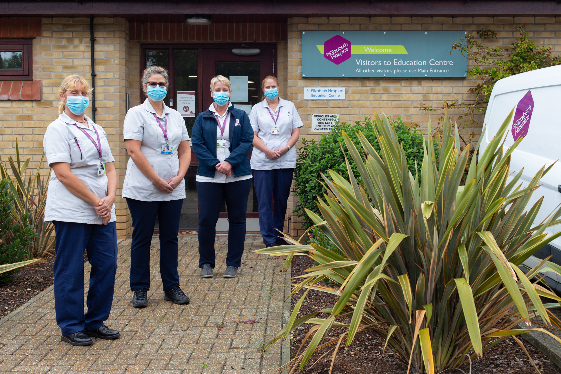 Health Care Assistants outside the Education Centre which has been transformed into The Hub